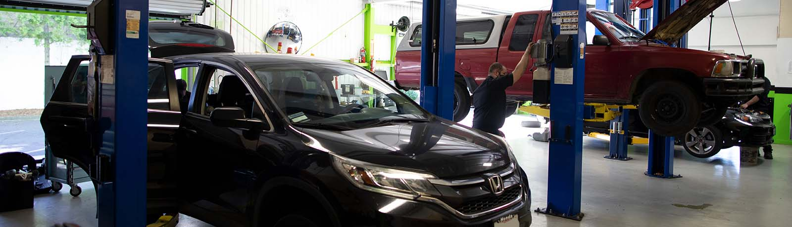 Auto Mechanic Repairing Car at GreenTech Automotive